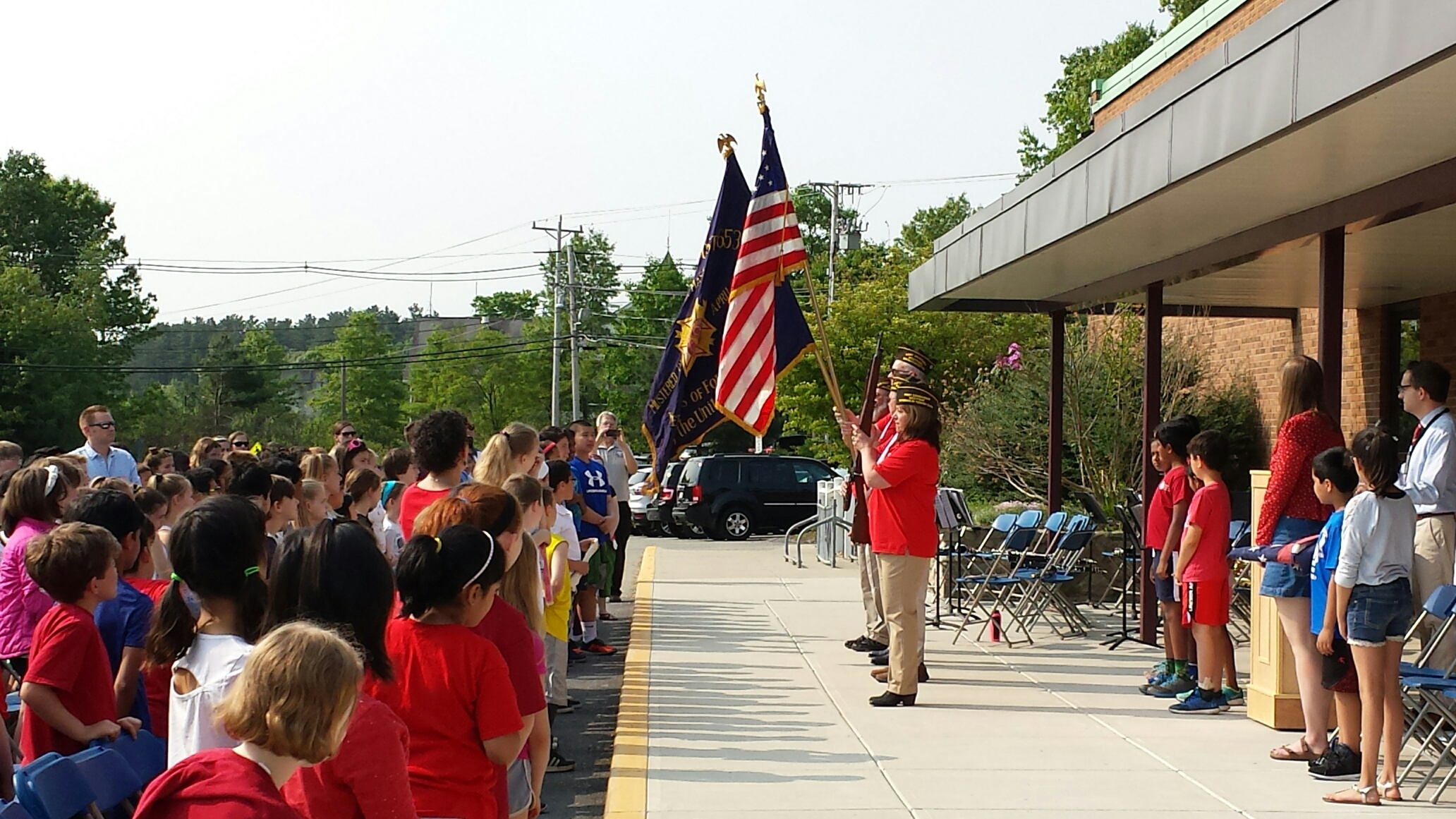 Color guard advancing the colors at the Day School Memorial Day program.