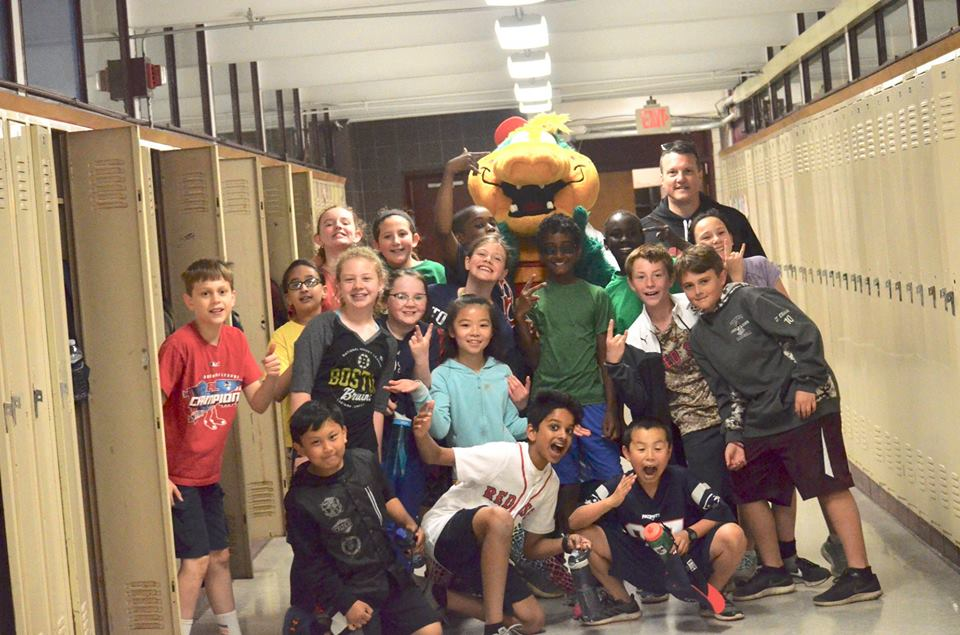 Mr. Whittlesey and his students posing with a Field Day mascot.