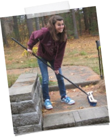 Student Sweeping Outside