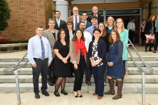 Image of Science Department faculty members, standing on front steps of Westford Academy