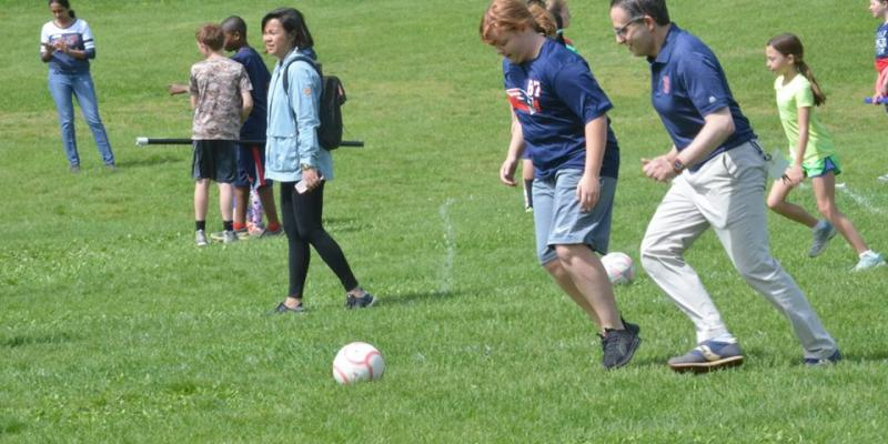 Day School students and Principal Chris Louis Sardella participating in field day activities.
